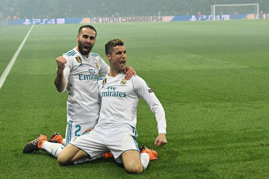 Real Madrid's Cristiano Ronaldo (right) celebrates scoring with Real Madrid's Dani Carvajal.