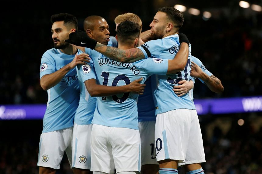 Manchester City players celebrate during a match against Southampton.