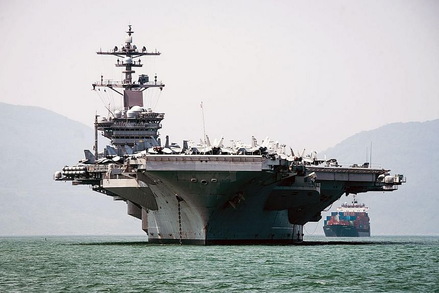 The USS Carl Vinson arriving in Danang on Monday. US officials heralded the visit of the nuclear-powered aircraft carrier as a milestone in ties between the US and Vietnam, once bitter enemies during the Vietnam War.