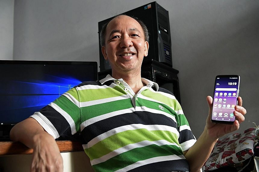 """Mr Liu Ming Ching, a volunteer working with IMDA to teach the elderly how to use technology, is keen on participating in the new courses to train seniors in digital skills. """"I can lead by example,"""" says the 59-year-old retiree."""