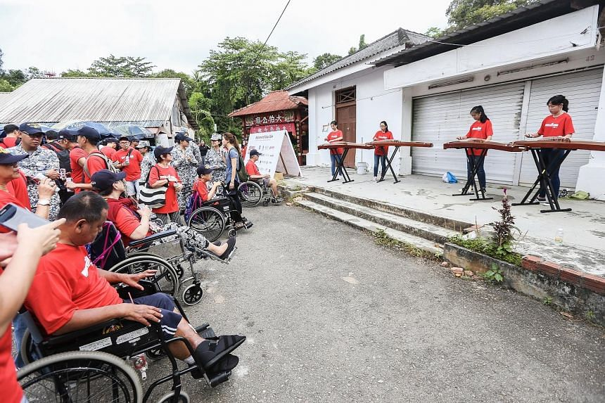 Mr Jurani Basri (above) was among 120 wheelchair users who toured Pulau Ubin last Friday with their caregivers and chaperones. The beneficiaries also enjoyed musical performances by polytechnic students.