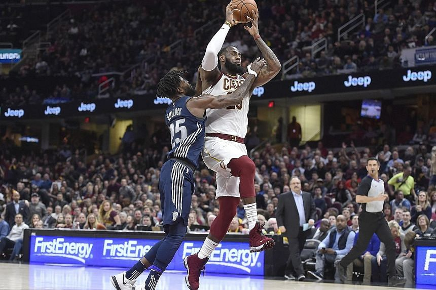 Cleveland Cavaliers forward LeBron James drives against Detroit Pistons forward Reggie Bullock en route to the Cavaliers' 112-90 victory. Despite sitting out the fourth quarter, James had 31 points, seven rebounds and seven assists as the Cavs improv
