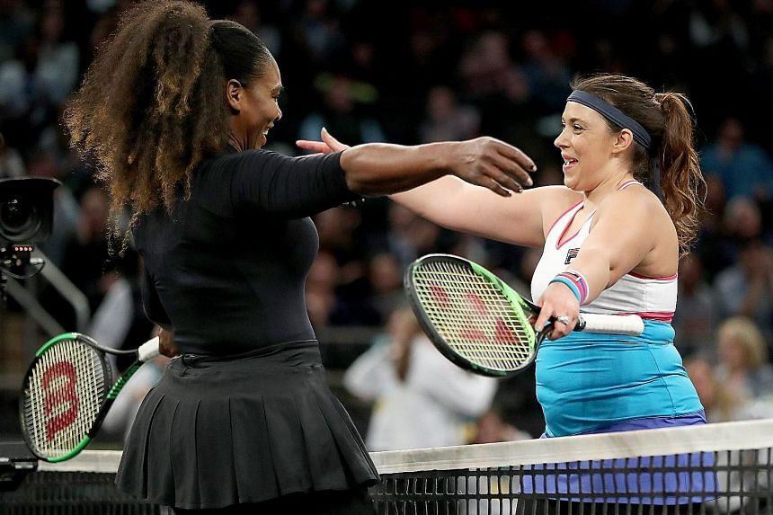 Marion Bartoli congratulating Serena Williams after the latter won their opening Tie Break Tens match at Madison Square Garden on Monday. Williams, who lost in the next round to China's Zhang Shuai, is making her return to the WTA Tour at Indian Well