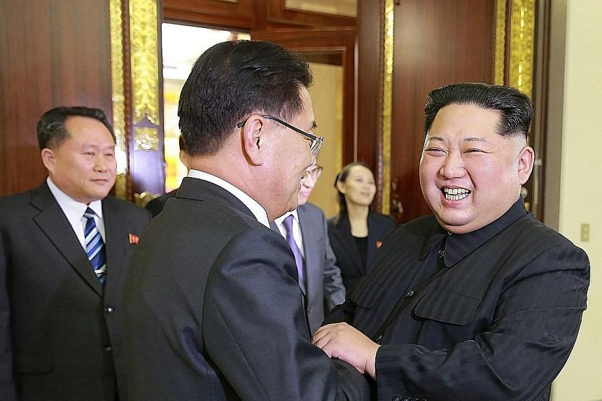 Above: North Korean leader Kim Jong Un (right) welcoming members of the South Korean delegation during their meeting in Pyongyang on Monday. It was his first meeting with top South Korean officials since he assumed power in 2011. Left: The visiting S
