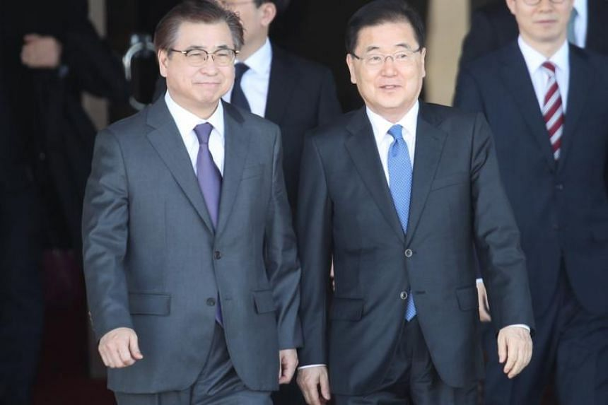Chung Eui Yong (right), the head of the presidential National Security Office, and Suh Hoon, chief of the National Intelligence Service, depart for Pyongyang from Seoul Airport in Seongnam, South Korea on March 5, 2018.