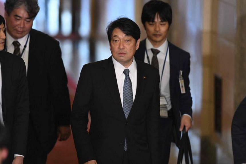 Japan's Defence Minister Itsunori Onodera (second right) arrives for a session of the House of Representatives Budget Committee in Tokyo on Feb 5, 2018.
