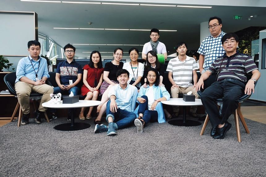 Mr Bon Seah (centre, seated in jeans) with his colleagues during his internship at Jinchuanmaike Metal Resources in Shanghai. PHOTO: BON SEAH