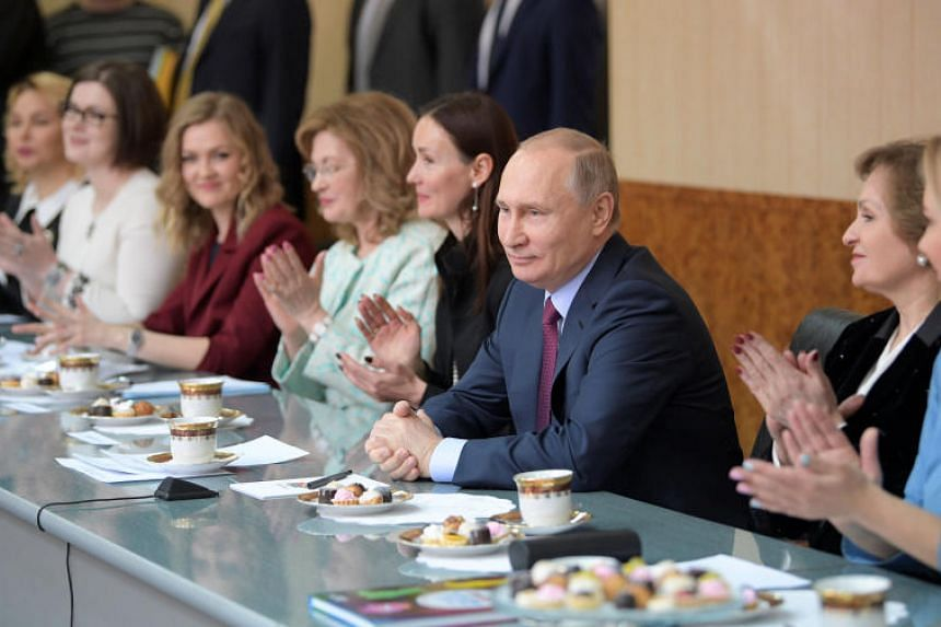 Russian President Vladimir Putin meets with regional female entrepreneurs ahead of the upcoming International Women's Day during his visit to the Samara bakery and confectionery factory in Samara, Russia, on March 7, 2018.