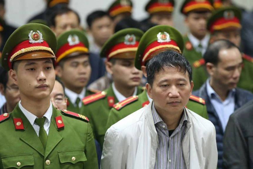 State company executive Trinh Xuan Thanh (right) was snatched last July 23 while walking in Berlin's central Tiergarten park and reappeared days later, in police captivity, on Vietnamese state TV.