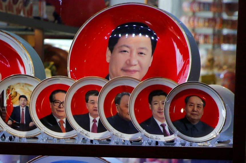 Souvenir plates bearing the faces of Chinese President Xi Jinping and former Chinese leaders are displayed on sale at a shop next to Tiananmen Square in Beijing, on March 1, 2018.