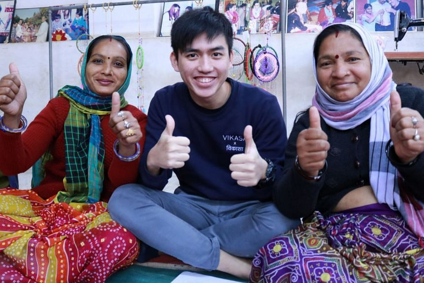 Ethan Loh, an undergraduate at SMU's School of Accountancy and Global Impact Scholar, with beneficiaries during Project Vikasa, an overseas community service project to India, in December 2017. PHOTO: FAITH LEE ANN