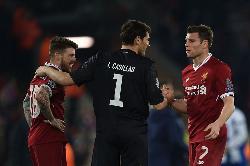 Porto goalkeeper Iker Casillas (centre) greets Liverpool's Alberto Moreno (left) and James Milner after the match.