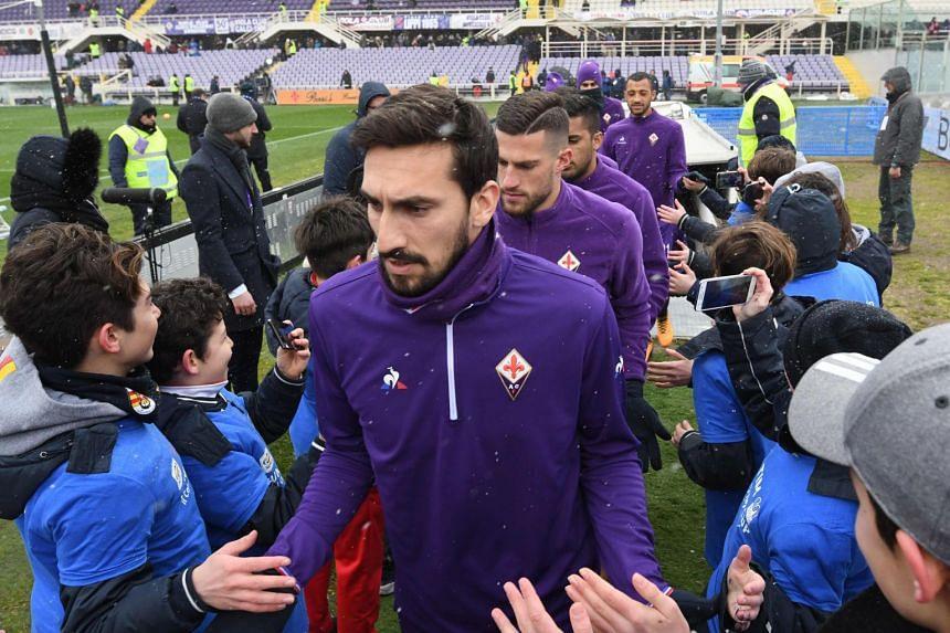 Astori and team mates enter the pitch on Feb 25, 2018, before an Italian Seria A match agfainst Chievo.
