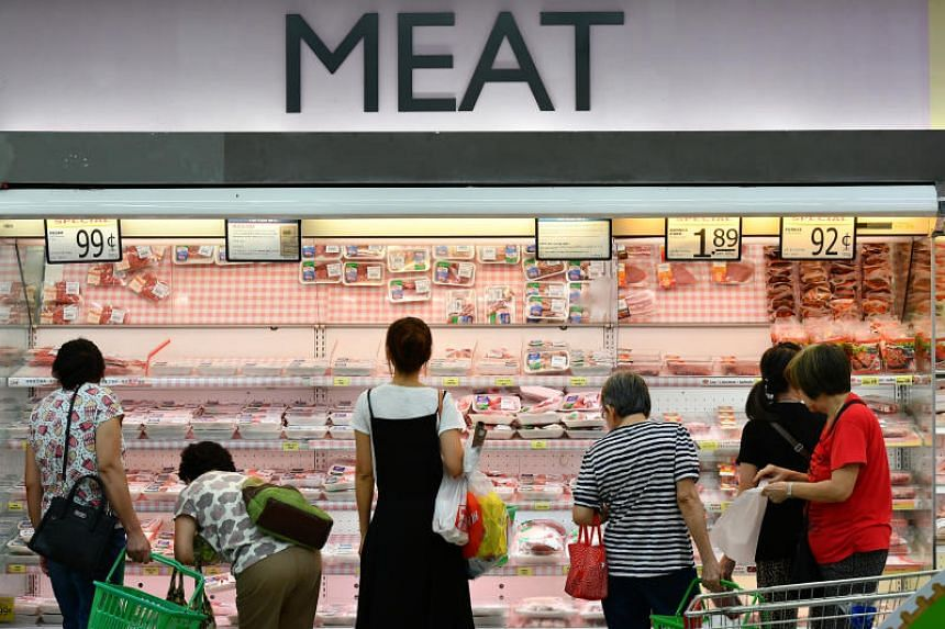 Shoppers at the meat section of the FairPrice Xtra supermarket at NEX on March 23, 2017.