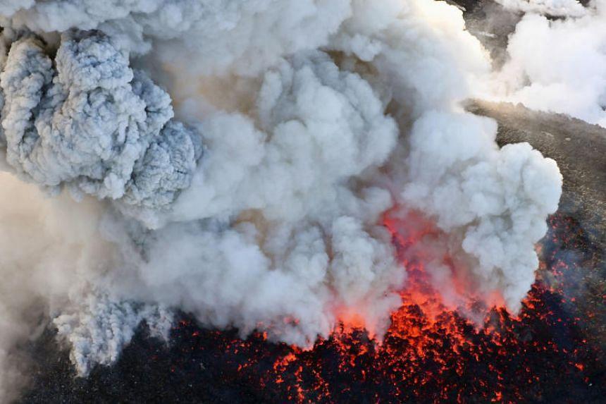 An aerial view shows Shinmoedake peak erupting between Miyazaki and Kagoshima prefectures, southwestern Japan, on March 6, 2018.