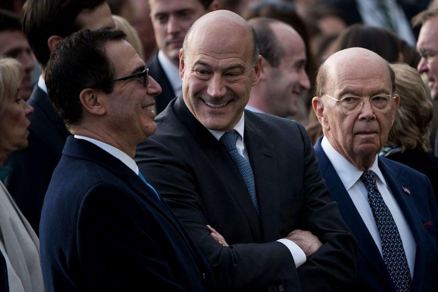 Cohn (centre) with Treasury Secretary Steven Mnuchin (left) and Commerce Secretary Wilbur Ross in December 2017.