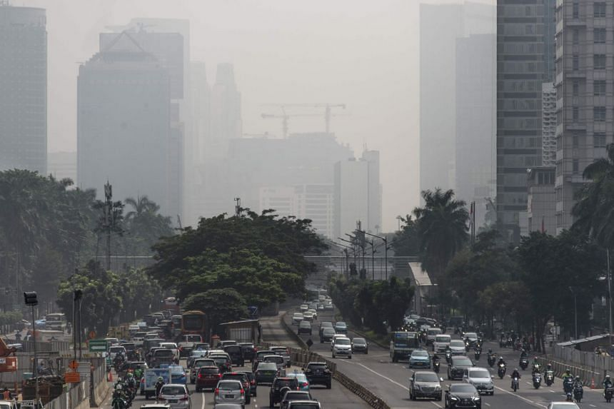 Buildings in downtown Jakarta are shrouded in a thick haze made worse by fires burning in rural provinces around the region, on Feb 23, 2018.