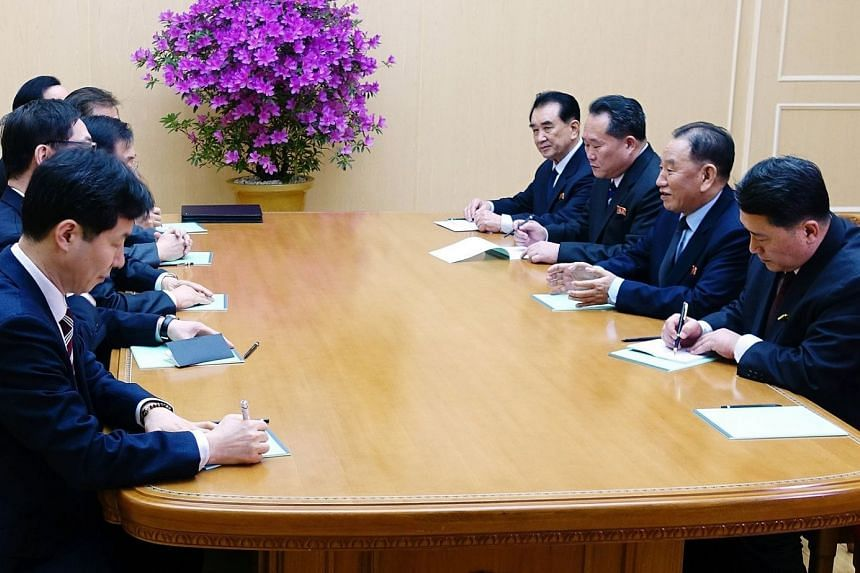 Mr Chung Eui Yong (third, left), the head of the South Korean presidential National Security Office, talks to Mr Kim Yong Chol (second, right), vice-chairman of the Central Committee of North Korea's ruling Workers' Party, during a meeting in Pyongya