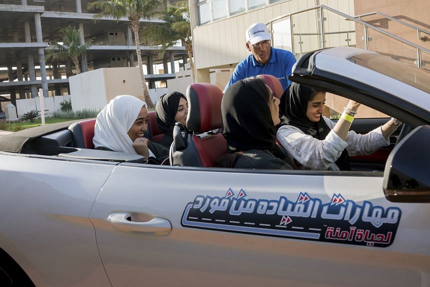 Saudi students taking part in a car safety course at Effat University in Jidda, Saudi Arabia. Reforms kick-started by Crown Prince Mohammed bin Salman include the historic decision allowing women to drive from June, attend football matches and take o