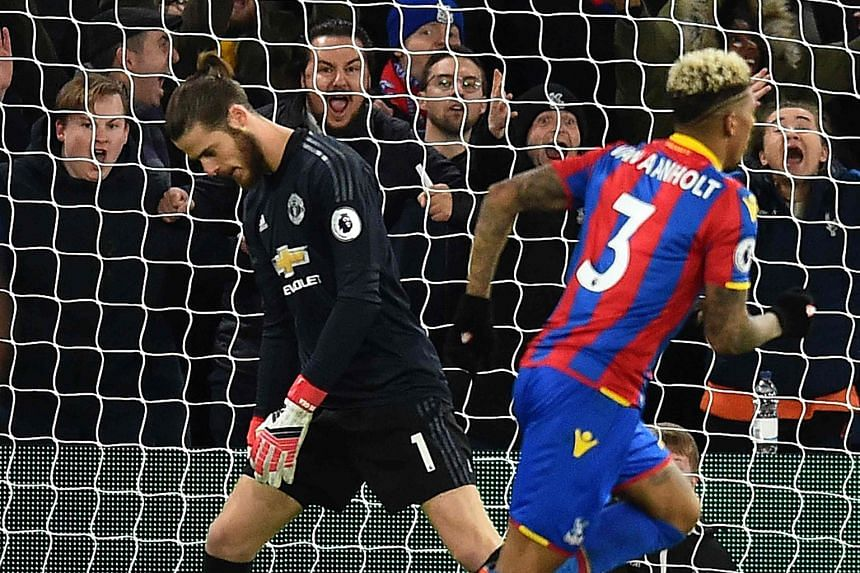 Goalkeeper David de Gea cannot hide his dejection after Crystal Palace's Patrick van Aanholt put the relegation-threatened side 2-0 up early in the second half. The Spaniard's anguish turned into joy in the end, as United left Selhurst Park with all