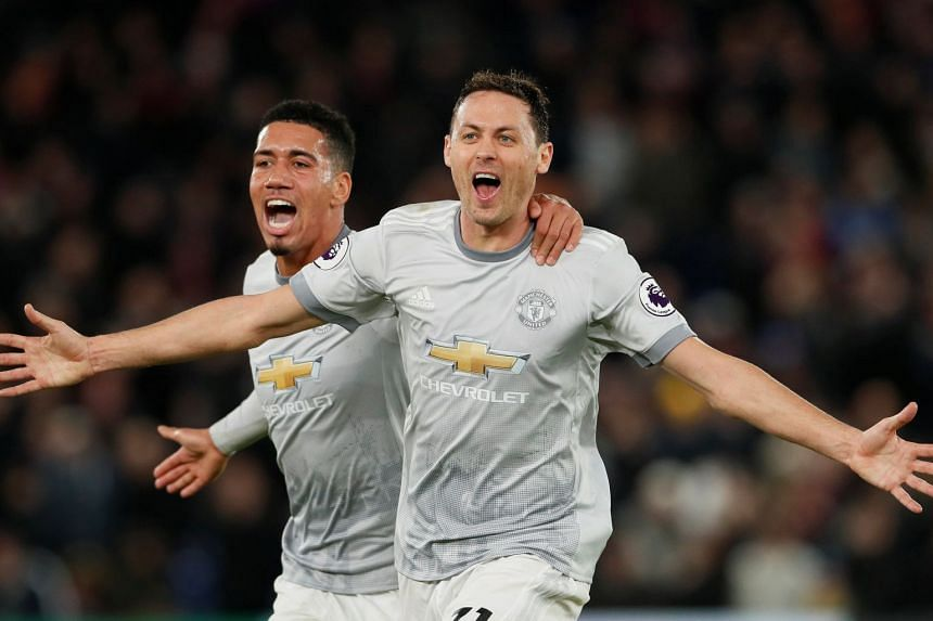 Nemanja Matic celebrating his late winner to complete Manchester United's comeback victory with Chris Smalling. The English defender had earlier scored United's first.