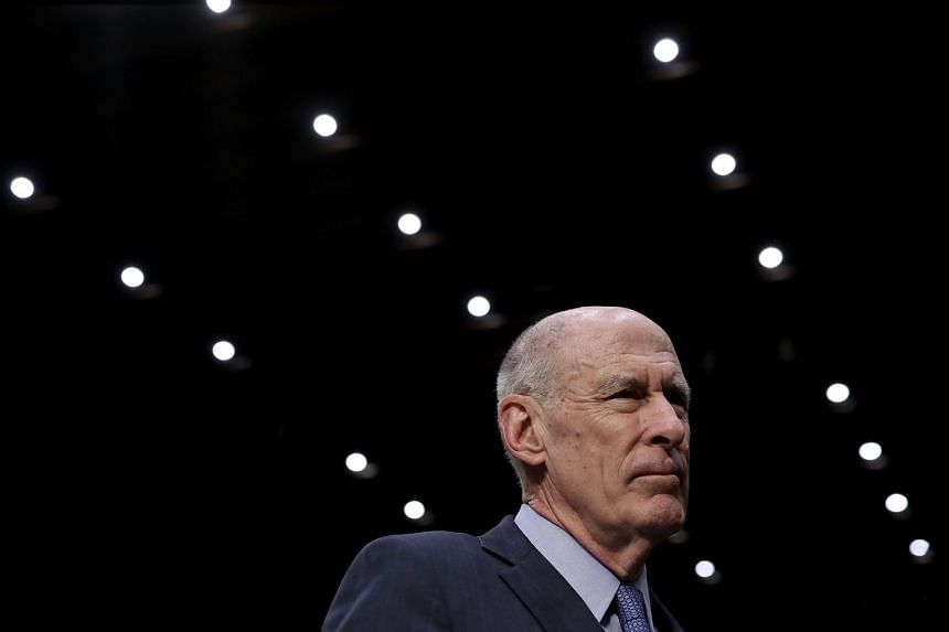 Coats arrives for testimony at a hearing held by the Senate Armed Services Committee.