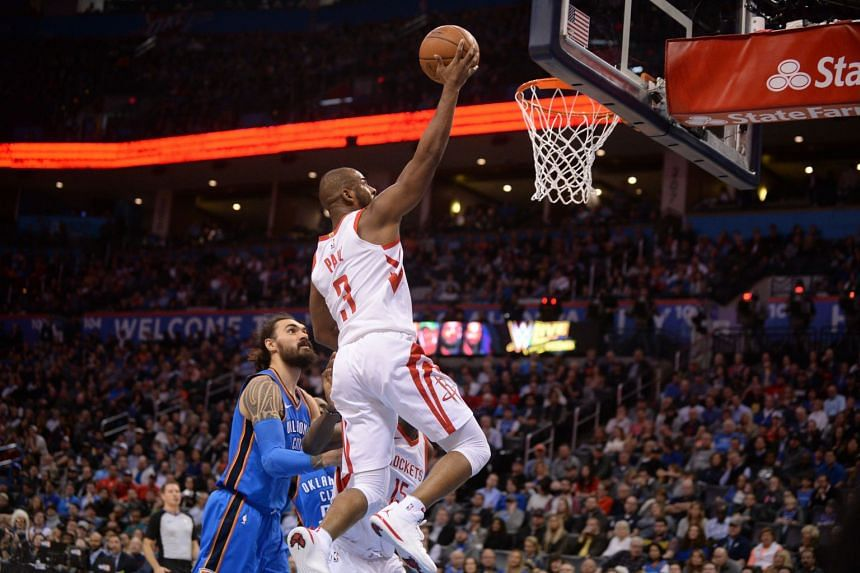 Houston Rockets guard Chris Paul (right) shoots the ball in front of Oklahoma City Thunder center Steven Adams (left) during the second quarter at Chesapeake Energy Arena.
