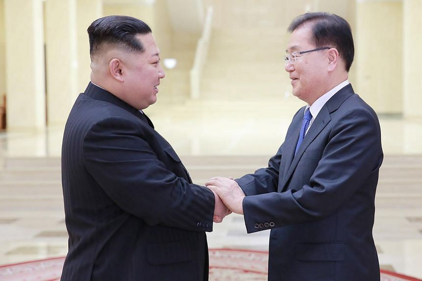 North Korean leader Kim Jong Un (left) shaking hands with Chung Eui Yong , the head of the South Korean presidential National Security Office, prior their meeting at Kobangsan Guesthouse in Pyongyang, on March 5, 2018.