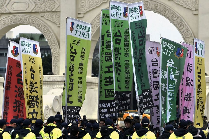 Pro-Taiwan indepedence activists displaying signs of Taiwan independent in front of the police during the 70th anniversary of the 228 incident in Taipei, Taiwan.