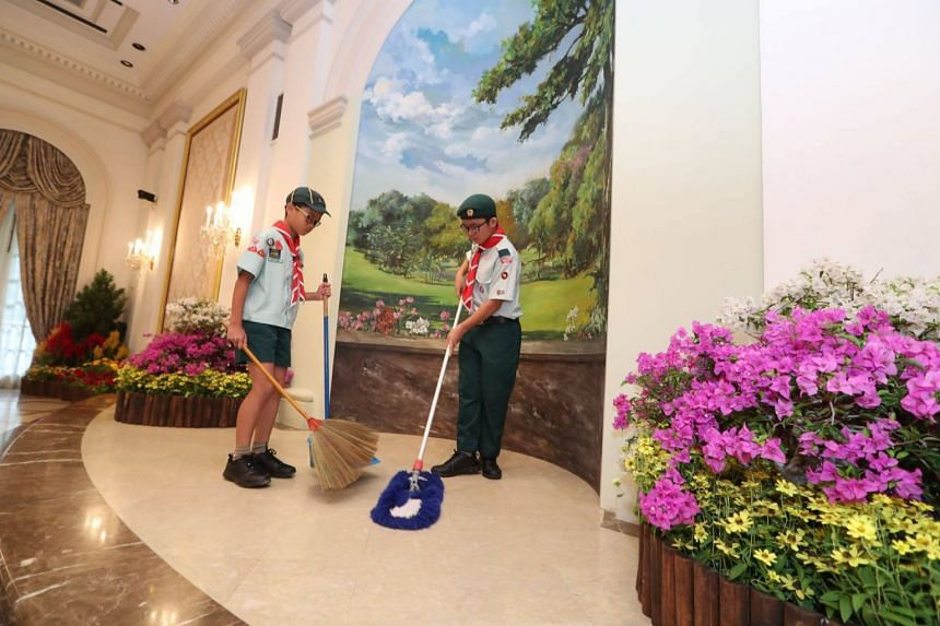 Twelve scouts, including two with special needs, spent the morning cleaning the Istana's lifts and floors and feeding swans in the garden.