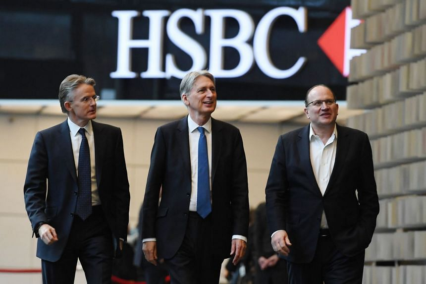 Hammond (centre) with HSBC CEO John Flint (left) and group chairman Mark Tucker at HSBC's London headquarters.