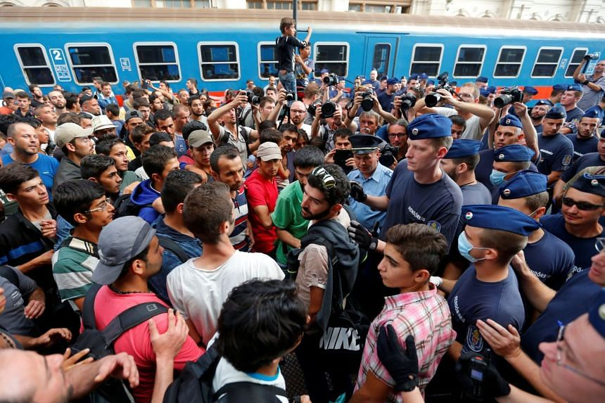 Migrants face Hungarian police in the main Eastern Railway station in Budapest in 2015.