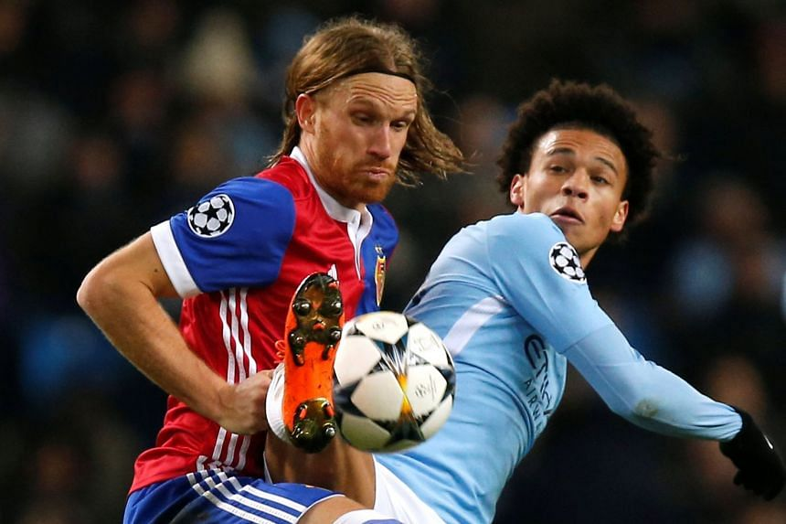 Basel's Michael Lang in action with Manchester City's Leroy Sane.