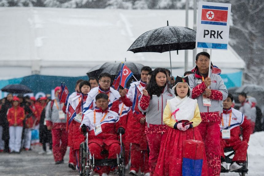 The delegation and the team of North Korea arrive at The Paralympic Village in Pyeongchang, March 8, 2018.