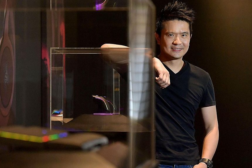 Razer chief executive Tan Min Liang (right) debuted on Forbes' billionaire list. Top of the list for Singapore were Far East Organization's Robert (above, far right) and Philip Ng.