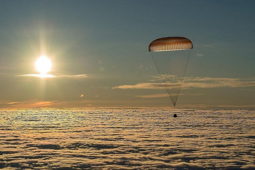 This image shows the Soyuz MS-06 capsule, carrying the crew of American astronauts Joe Acaba and Mark Vande Hei as well as Russian cosmonaut Alexander Misurkin, descending just before landing in a remote area outside the town of Dzhezkazgan, Kazakhst