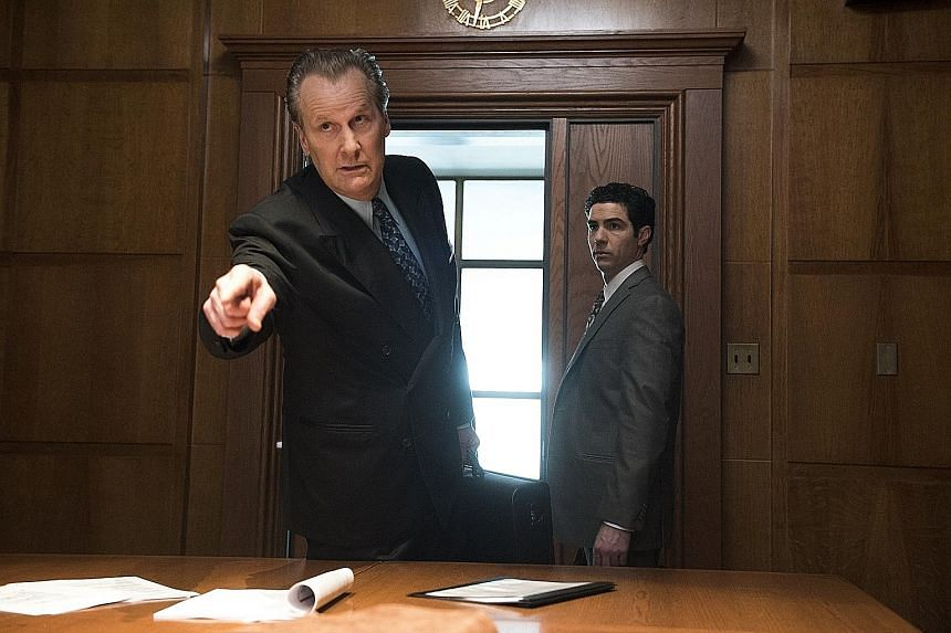 In The Looming Tower, Jeff Daniels plays FBI's magnetic but flawed counter-terrorism chief John O'Neill (far left) and Tahar Rahim plays his junior agent Ali Soufan.
