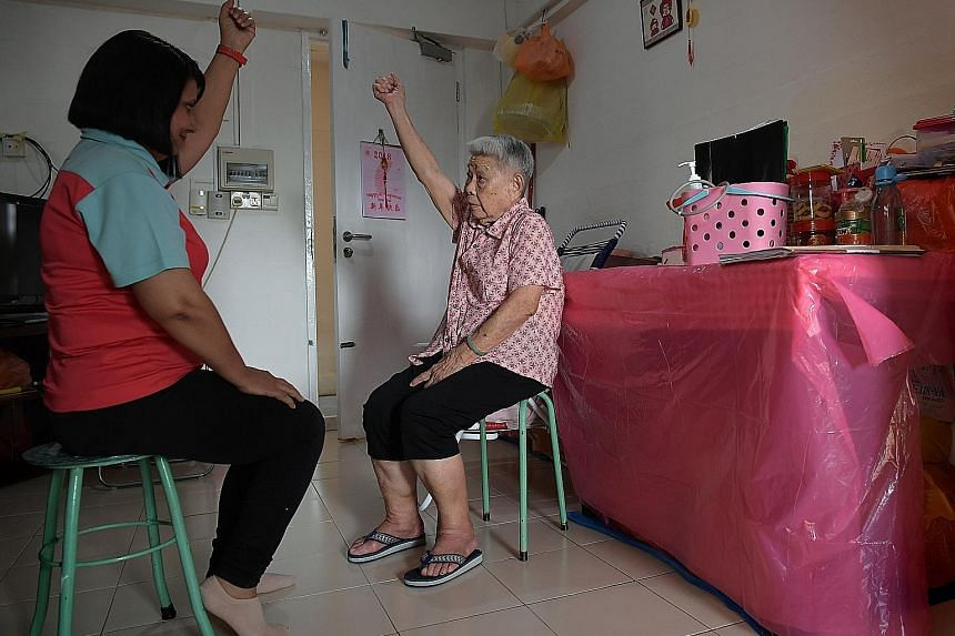 Care coordinator Poonam Bala, 50, manages the health needs of Madam Lock Ah Sim, 86. She takes Madam Lock's blood pressure, checks her medication and does light exercises with her. Madam Lock is part of the Care Close to Home programme, which helps s