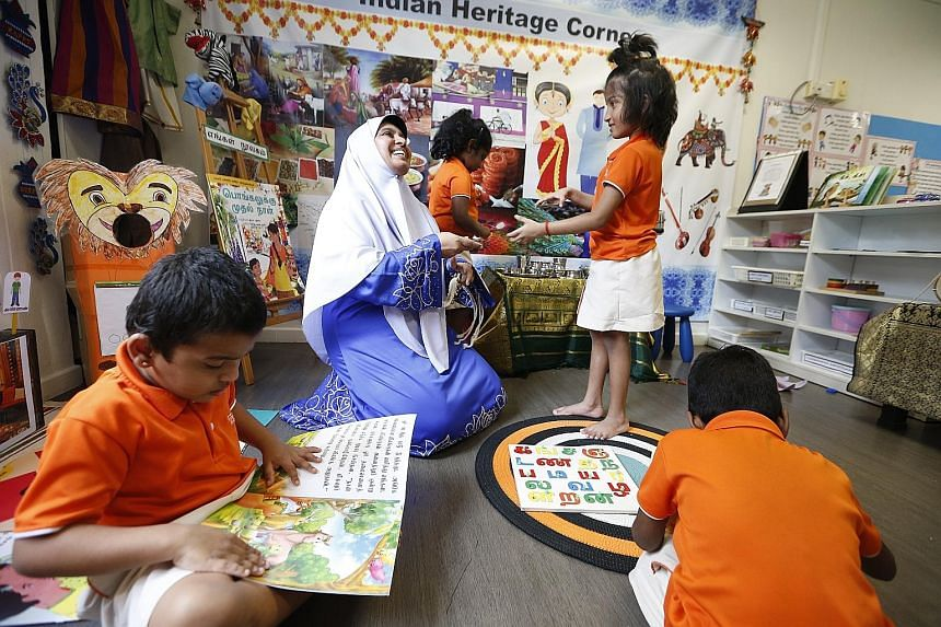 Tamil language teacher Aisha Banu with children at the My First Skool centre in Yishun. By 2022, about 350 pre-schools run by anchor operators will offer Tamil and Malay classes, up from about 200 now. More Ministry of Education kindergartens will al