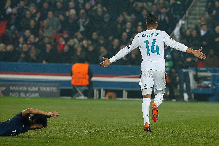 Top: Real Madrid's Casemiro celebrating his winner in the Champions League last 16 second leg at Paris Saint-Germain. Team-mate Cristiano Ronaldo opened the scoring before Edinson Cavani equalised. Real won 2-1 to advance 5-2 on aggregate. Above: PSG