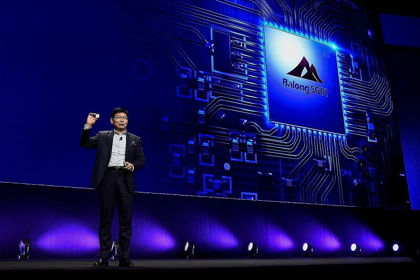 Huawei chief executive for consumer business Richard Yu presenting the new Huawei Balong 5G01, a 3GPP 5G commercial chipset, on Feb 25 in Barcelona, on the eve of the inauguration of the Mobile World Congress.