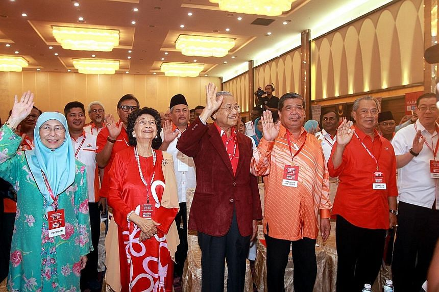 From left: Parti Keadilan Rakyat president Wan Azizah Wan Ismail at a PH convention in Shah Alam earlier this year with Tun Siti Hasmah and her husband Mahathir Mohamad of the Parti Pribumi Bersatu Malaysia; Parti Amanah Negara president Mohamed Sabu