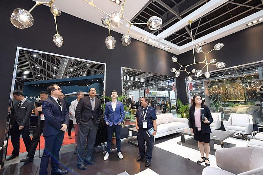 Minister for Trade and Industry (Industry) S. Iswaran at the Novaz Furniture booth while touring the Singapore Furniture Fair 2018 at the Singapore Expo.