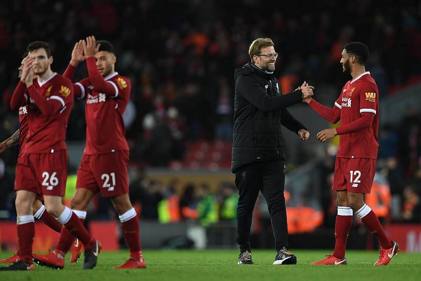 Liverpool's manager Jurgen Klopp congratulates Liverpool's defender Joe Gomez (right) after the English Premier League football match between Liverpool and Leicester at Anfield in Liverpool, England on Dec 30, 2017.