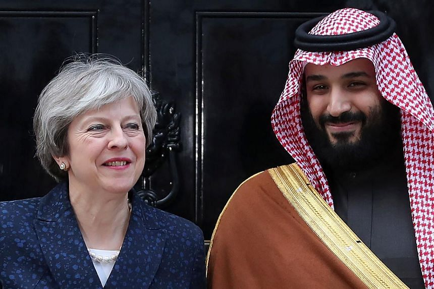 Britain's Prime Minister Theresa May poses with Saudi Arabia's Crown Prince Mohammed bin Salman outside 10 Downing Street, in London on March 7, 2018.