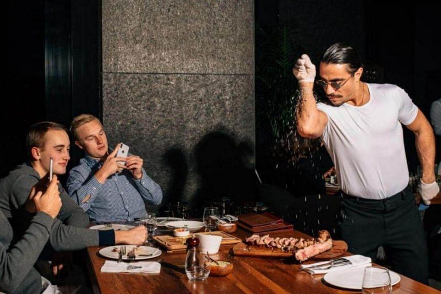 Nusret Gokce performs his signature salting technique at his Nusr-Et Steakhouse in Manhattan, on Feb 2, 2018.