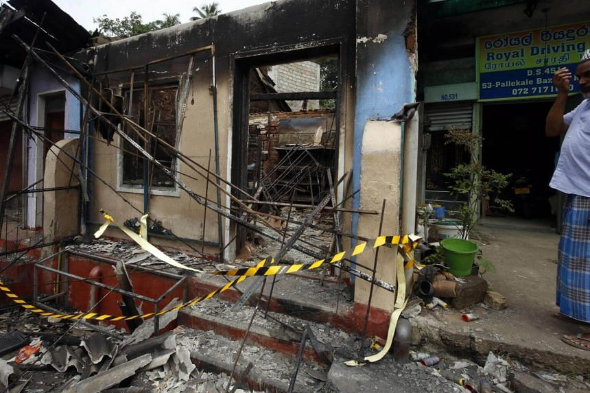 A Sri Lankan Muslim from among the Moor community standa at his business establishment which had been attacked and looted at the Pallekelle town in Kandy, Sri Lanka, on March 7, 2018.