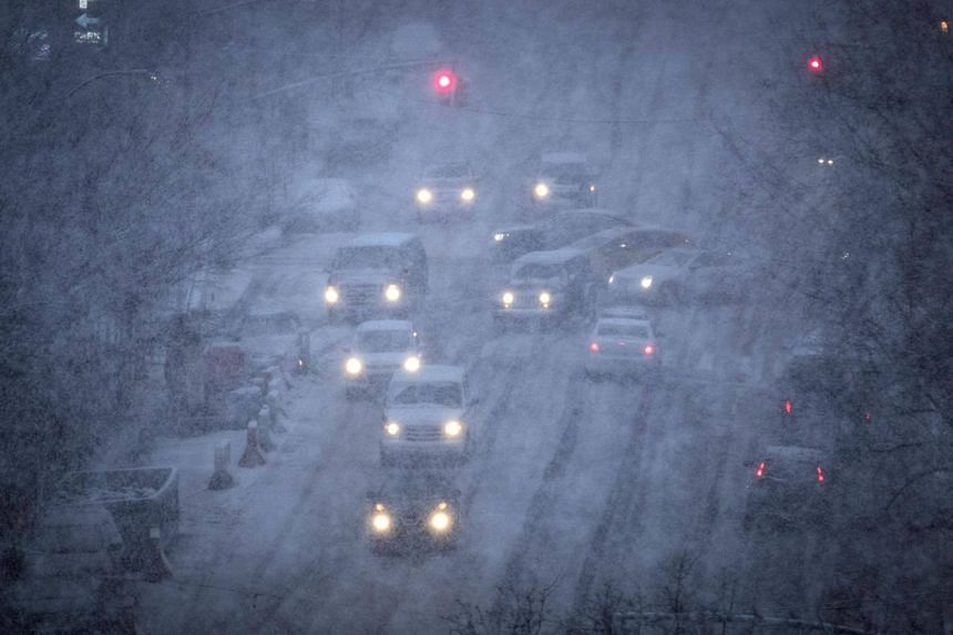 Vehicles navigate the road conditions on Atlantic Avenue in Brooklyn during a snowstorm on March 7, 2018.