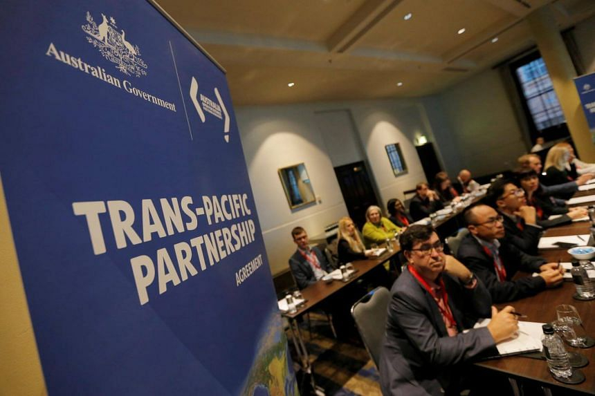 Delegates participate in the opening session of the Trans-Pacific Partnership senior leaders meeting in Sydney, Australia on Aug 28, 2017.