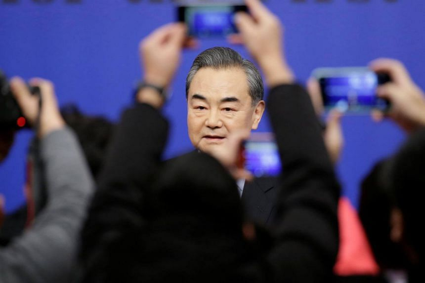Speaking on the sidelines of an annual meeting of China's parliament,  Foreign Minister Wang Yi said some outside forces were trying to muddy the waters in the disputed region.
